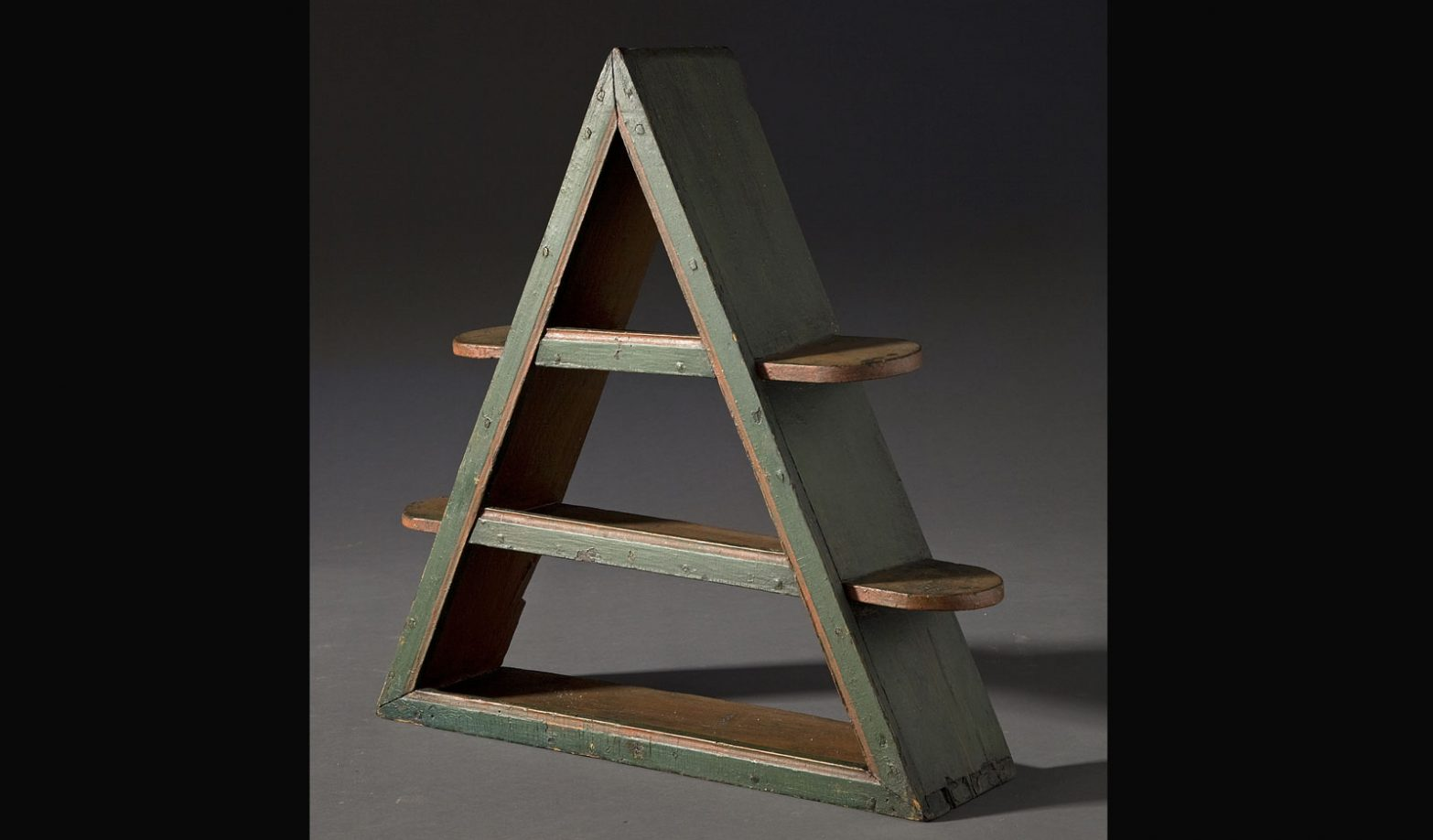Triangular green wall shelf just folk - Triangular bookshelf ...